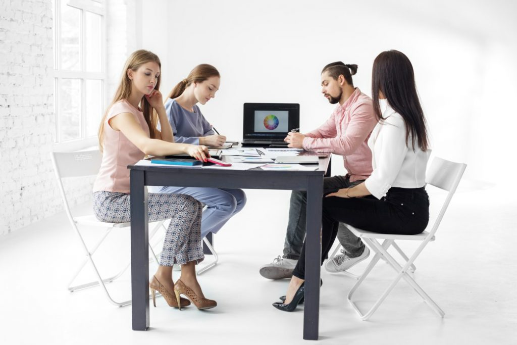 Group of people inside a coworking environment.