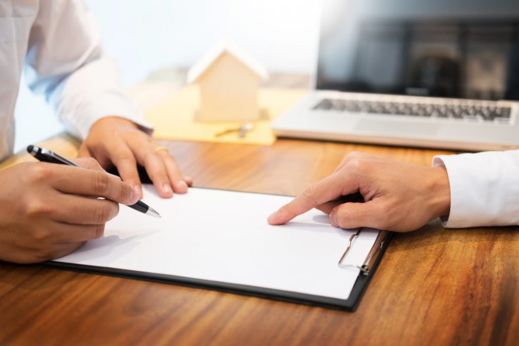 Signing a Tenancy Agreement to secure the rights of the commercial tenant.