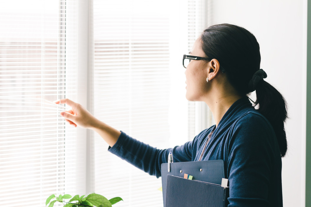 hr professional - virtual office space rental - an employee inspects an office space in singapore
